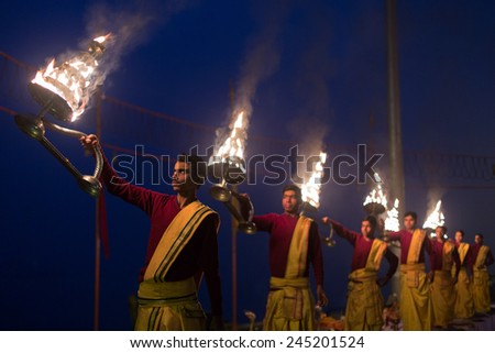 VARANASI, INDIA-JAN 19:A Hindu priest performs the Ganga Aarti ritual on Jan, 19, 2015 in Varanasi.Fire puja is a Hindu ritual that takes place at Assi Ghat on the banks of the river Ganges - stock photo