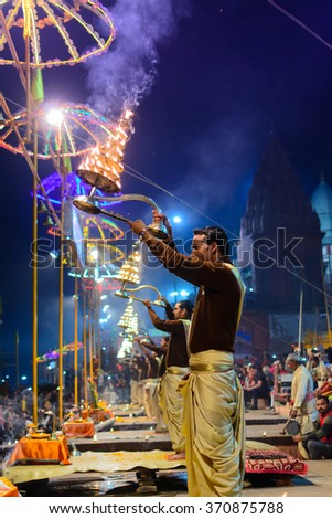 VARANASI, INDIA-January 14 , 2016: A Hindu priest performs the Ganga Aarti ritual in Varanasi.Fire puja is a Hindu ritual that takes place at Dashashwamedh Ghat on the banks of the river Ganges