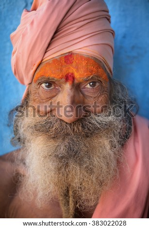 VARANASI - INDIA - JANUARY 7, 2016: Unidentified sadhu (holy man) on the ghats of Ganges on January 7, 2016 in Varanasi, India. Varanasi is the holiest of the seven sacred cities in India. - stock photo