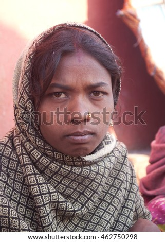 VARANASI, INDIA- 9 MAR 2013: Portrait of unidentified Hindu Woman pilgrims on ghats of  Holy river Ganges on the auspicious Maha Shivaratri festival.