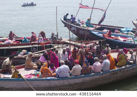 VARANASI, INDIA- MAR 09 : Unidentified Crowd of Hindu pilgrims carrying out a religious ceremony at the sacred ghats of holy river Ganges, March 09, 2013 Varanasi, Uttar Pradesh, India. - stock photo