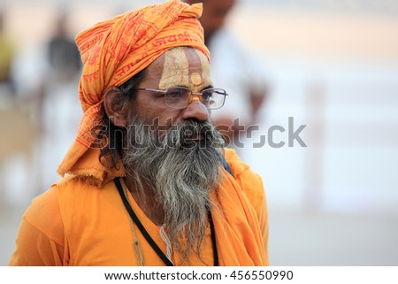 VARANASI, INDIA- MAR 03:Unidentified Hindu saint stands in the ghats of the river Ganges on March 03, 2016 in Varanasi, Uttar Pradesh, India.Varanasi is the most popular Hindu pilgrim place in India. - stock photo