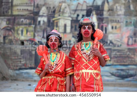 VARANASI, INDIA- MAR 03:Unidentified men wear costume of Hindu God 'Hanuman' at the river ghat on March 03, 2016 in Varanasi, Uttar Pradesh, India.Varanasi is the most popular pilgrim place in India. - stock photo