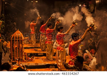 VARANASI, INDIA- 9 MARCH 2013 : A Hindu priest performs the Ganga Aarti ritual  in Varanasi. Fire puja is a Hindu ritual that takes place at Dashashwamedh Ghat on the banks of the river Ganges