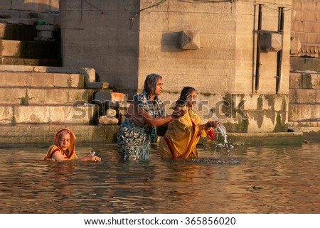 Varanasi, India-March 19,2013 :Hinduism and Buddhism have similarities in the Ganges culture, these unidentified hindu and buddhist people live, pray and share together around the temples.  - stock photo