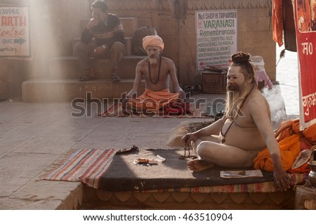 VARANASI - INDIA - 9 MARCH 2013 : Unidentified Naga Sadhu (holy man) on the ghats of Ganges on March 9, 2013 in Varanasi, India.