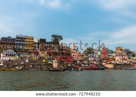 VARANASI, INDIA - MARCH 14, 2016: Wide angle picture Dashashwamedh Ghat in Ganges River during day time in Varanasi, India.