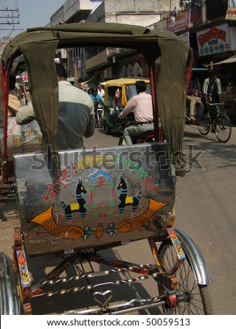 VARANASI, INDIA - NOV 7:  Rickshaw drivers carry local passengers  on Nov 7, 2009,  in Varanasi, India.