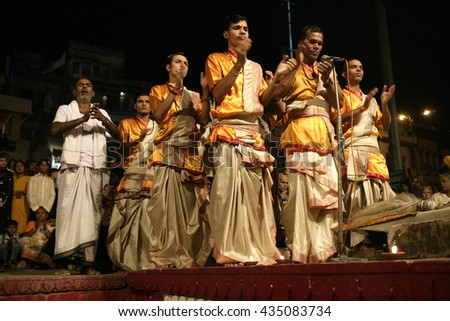 VARANASI, INDIA, 25 November 2006. A Hindu priest performs the Ganga Aarti ritual in Varanasi. - stock photo