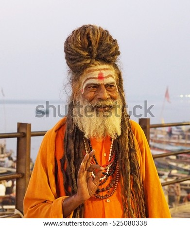 Varanasi, India - October 31, 2016: Portrait of an Indian sadhu wearing traditional attire by the sacred Ganges river in Varanasi, Uttar Pradesh, India.