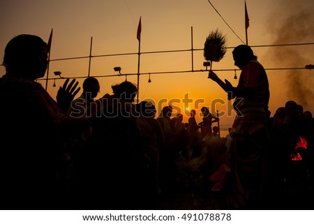VARANASI, INDIA - OCTOBER 24, 2014: Silhouette of the Puja ceremony when the sun rises on the banks of the Ganges Varanasi, India.