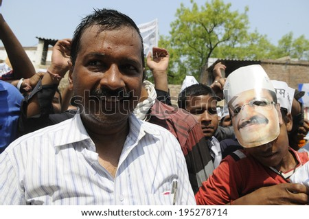 VARANASI - MAY  4 : Arvind kejriwal   looking bewildered along with one of his supporter wearing his face mask during a political meeting on May 4 , 2014 in Varanasi , India. - stock photo