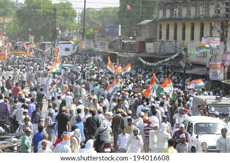 VARANASI - MAY 10: Congress party supporters flocking the streets during a road show  to support local Congress candidate Mr. Ajay Rai on May 10, 2014 in Varanasi , India. - stock photo