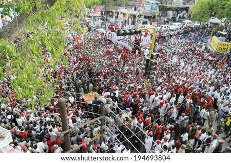 VARANASI-MAY 10: Followers of Samajwadi Party flocking the streets  during an election rally of UP Chief Minister Akhilesh Yadav on May 10, 2014 in Varanasi , India. - stock photo