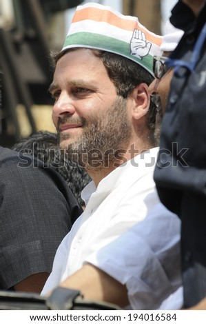 VARANASI - MAY 10: Rahul Gandhi  wearing a Congress cap during a road show  to support local Congress candidate Mr. Ajay Rai on May 10, 2014 in Varanasi , India. - stock photo