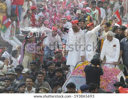VARANASI-MAY 10:  UP Chief Minister Akhilesh Yadav  and his followers on an open jeep waiving towards the crowd during an election rally on May 10, 2014 in Varanasi , India.