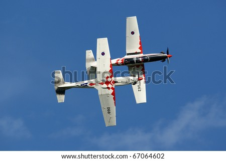 VARAZDIN, CROATIA - JUNE 12: Two airplanes of Krila Oluje - Croatian Air Force aerobatic display team at very close distance on the Varazdin airshow, Croatia, June 12, 2009