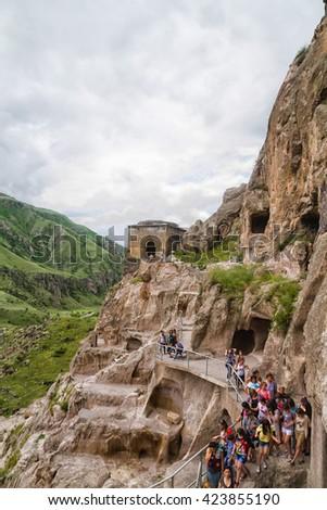 VARDZIA, GEORGIA - JUNE 11, 2013: Vardzia cave city-monastery in Georgia. Vardzia was excavated in the Erusheti Mountain in the 12th century and is one of the main attractions of the country. - stock photo