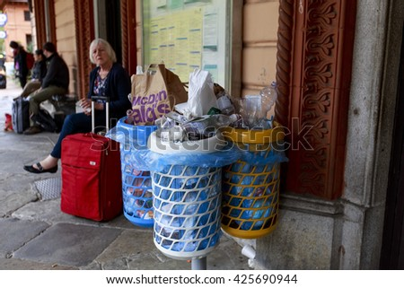 VARENNA-ITALY-MAY-9-2016:Overflowing colorful garbage bins with household waste in the train station - stock photo