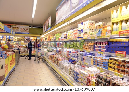 VARESE, ITALY-APRIL 11, 2014: Packaged foods in a supermarket aisle, in Varese.