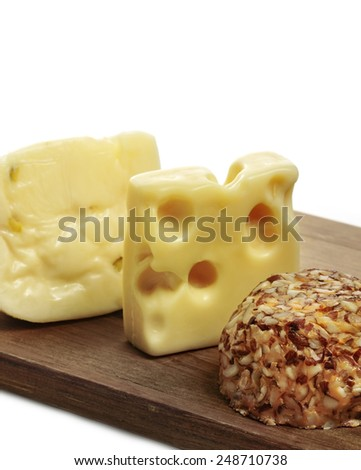 Variation Of Cheese On A Cutting Board