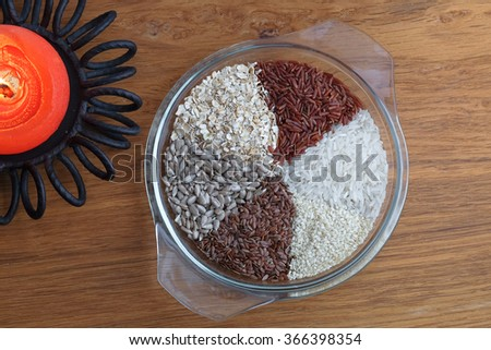 Variation of different rice, lentils,sesame and sunflower seed in glass place. Leguminous collection. - stock photo