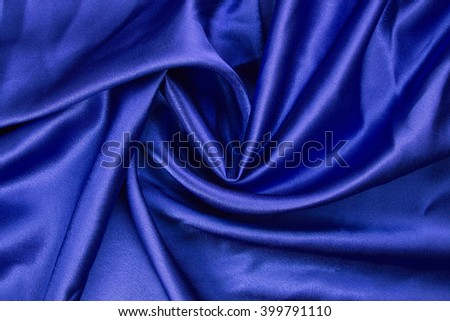 Variation of scene-background with blue velvet with spiral folds. - stock photo