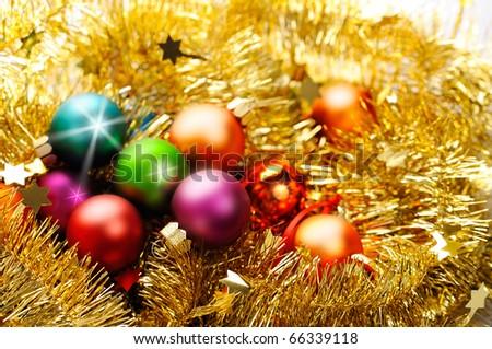Varicoloured christmas balls yellow tinsel - stock photo
