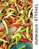 varied chilis at marketplace - stock photo
