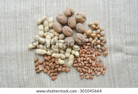 varied selection nuts, walnuts, almonds, peanuts, peeled, peanuts in the shell  - stock photo