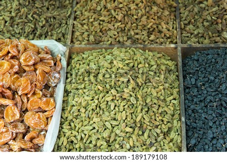 Varieties of dried fruit and nuts in market, Dong Dajie, Dunhuang, Jiuquan, Gansu Province, China - stock photo