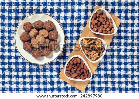 Varieties of nuts: almonds, hazelnuts and walnuts and chocolate balls - stock photo