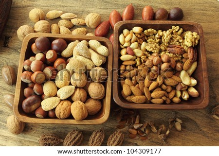 Varieties of nuts: peanuts, almonds, chestnuts, walnuts,  pistachio and pecans. Food and cuisine.