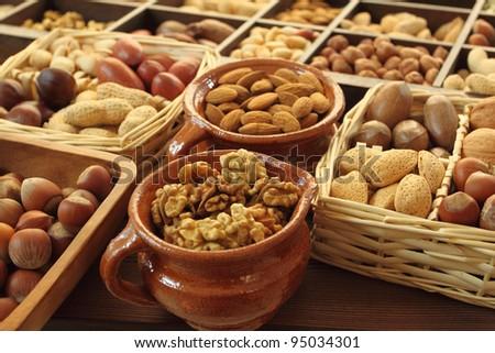 Varieties of nuts: peanuts, hazelnuts, chestnuts, walnuts,  pistachio and pecans. - stock photo