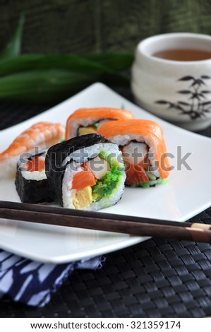 varieties sushi dish with hot tea for lunch