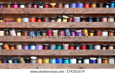variety color threads on the wood rack