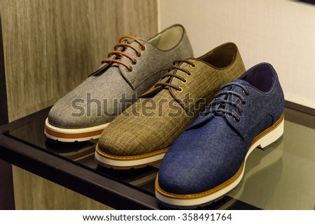 Variety colorful leather casual derby shoes on the shelf in the menâ??s fashion footwear and accessories shop in Singapore. Casual, fashion and work shoes for men.