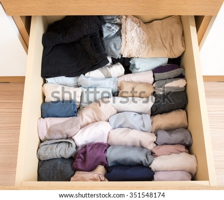 Variety of adult panties in the  wooden drawer. - stock photo
