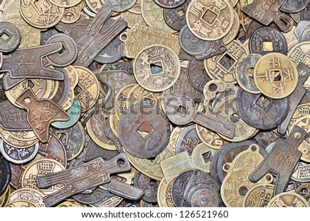 Variety of ancient Chinese coins with different forms and shapes - stock photo