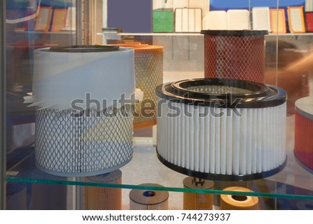 Variety of automotive air filters are on display in the spare parts store