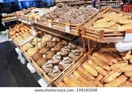 Variety of baked products at a supermarket - stock photo