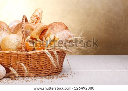 Variety of baked products in basket. Copy space on right