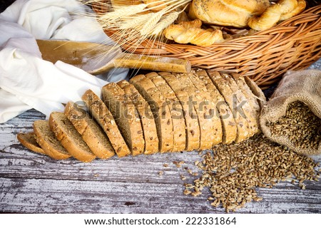 Variety of baked products in basket on wooden table