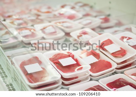 Variety of beef slices in boxes in supermarket - stock photo
