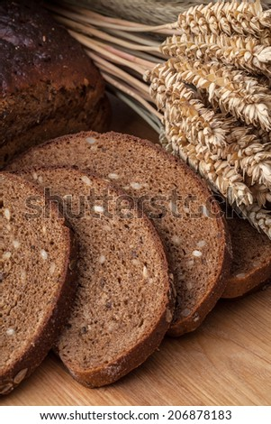 Variety of black lithuanian bread on wooden table.