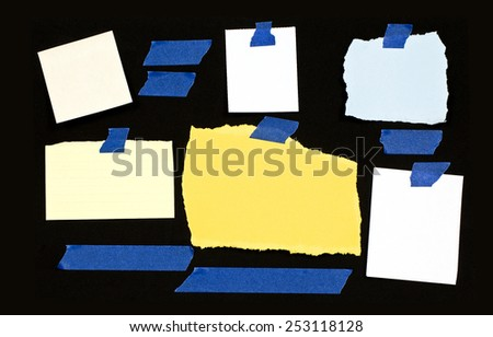 Variety Of Blank Torn Notes On Black Background - stock photo