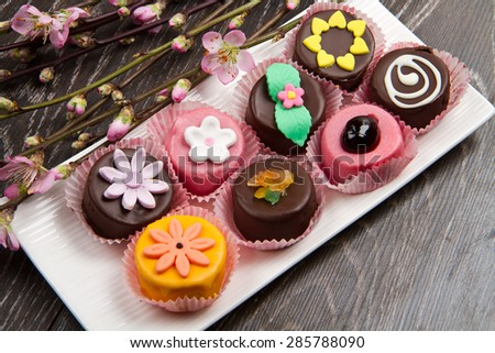 variety of cassate sicily dessert with spring flower on wood - stock photo