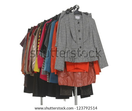 Variety of casual coat clothes hanging - stock photo