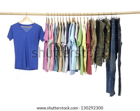 Variety of casual shirts and jeans on wooden hangers - stock photo