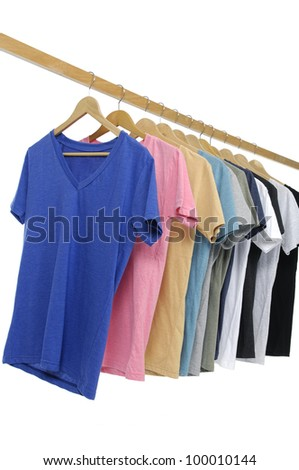 Variety of casual shirts on wooden hangers, isolated